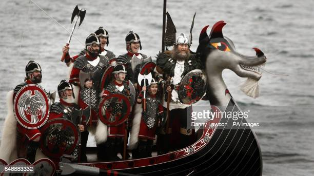 Guizer Jarl David Nicolson and members of the Jarl Squad dressed in Viking costumes on a Viking galley in Lerwick on the Shetland Isles during the Up...