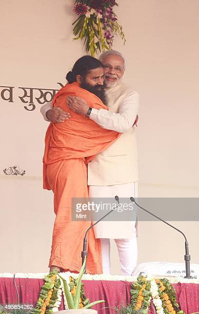 Gujarat Chief Minister and BJP Prime Ministerial candidate Narendra Modi hugs Yog Guru Baba Ram Dev at Yog Mahotasv at Ramlila ground on March 23...