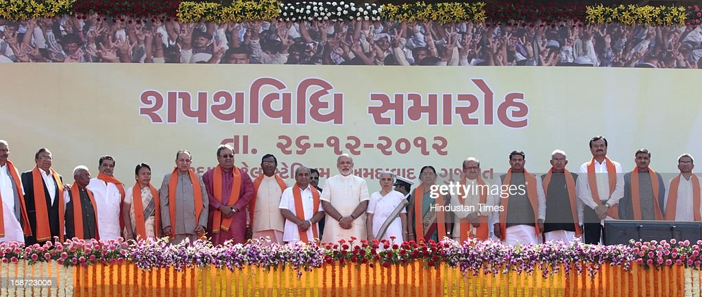 Gujarat Chief Minister Narandra Modi Narendra Modi along with his 16 member ministry cabinet after swearing in ceremony at a grand function at Sardar Patel Stadium on December 26, 2012 in Ahmedabad, India. Narendra Modi sworn as Chief Minister of Gujarat for fourth successive term.