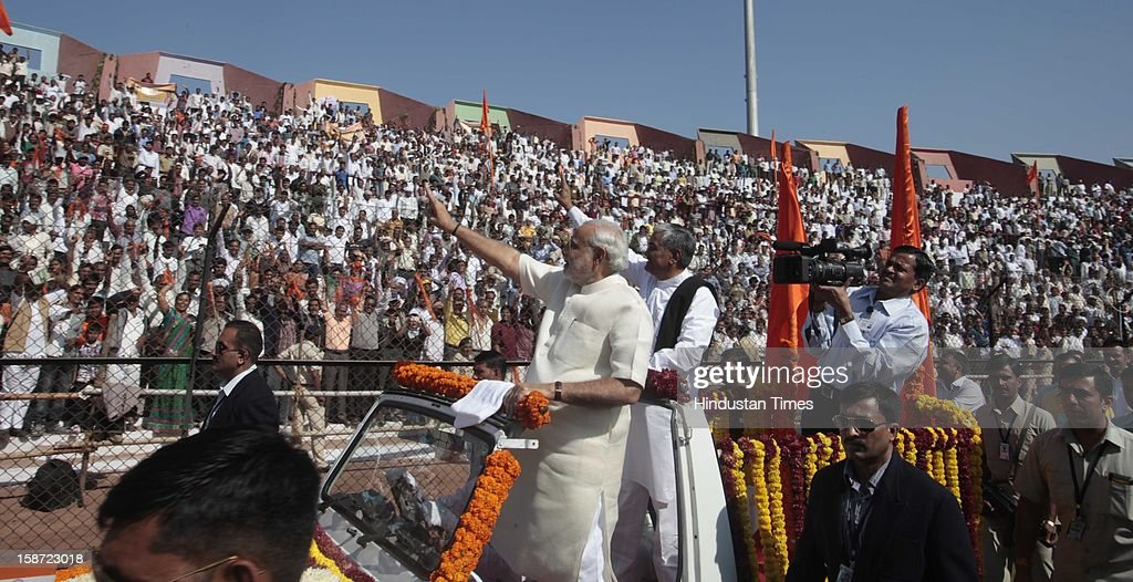 Gujarat Chief Minister Narandra Modi Narendra Modi greets his supporters during his swearing in ceremony at a grand function at Sardar Patel Stadium on December 26, 2012 in Ahmedabad, India. Narendra Modi sworn as Chief Minister of Gujarat for fourth successive term along with 16 ministers.