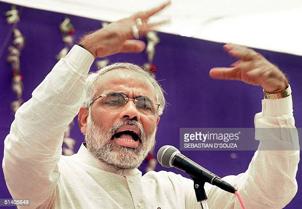 Gujarat Chief Minister Narendra Modi gestures as he addresses riot affected people in Ahmedabad, 01 May 2002. India's government survived a censure...