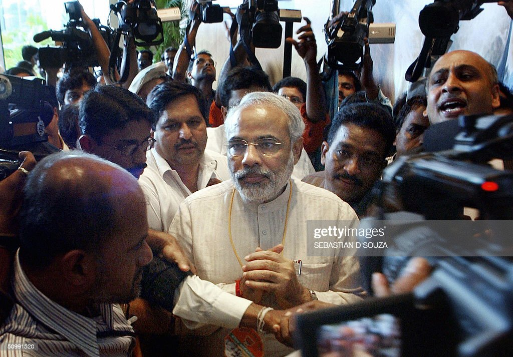 Gujarat Chief Minister Narendra Modi (C) : News Photo
