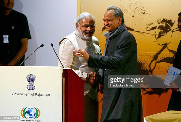 Gujarat Chief Minister Narendra Modi with Chief Minister of Rajasthan Ashok Gehlot on the concluding day of the Pravasi Bharatiya Divas 2012 at Birla...
