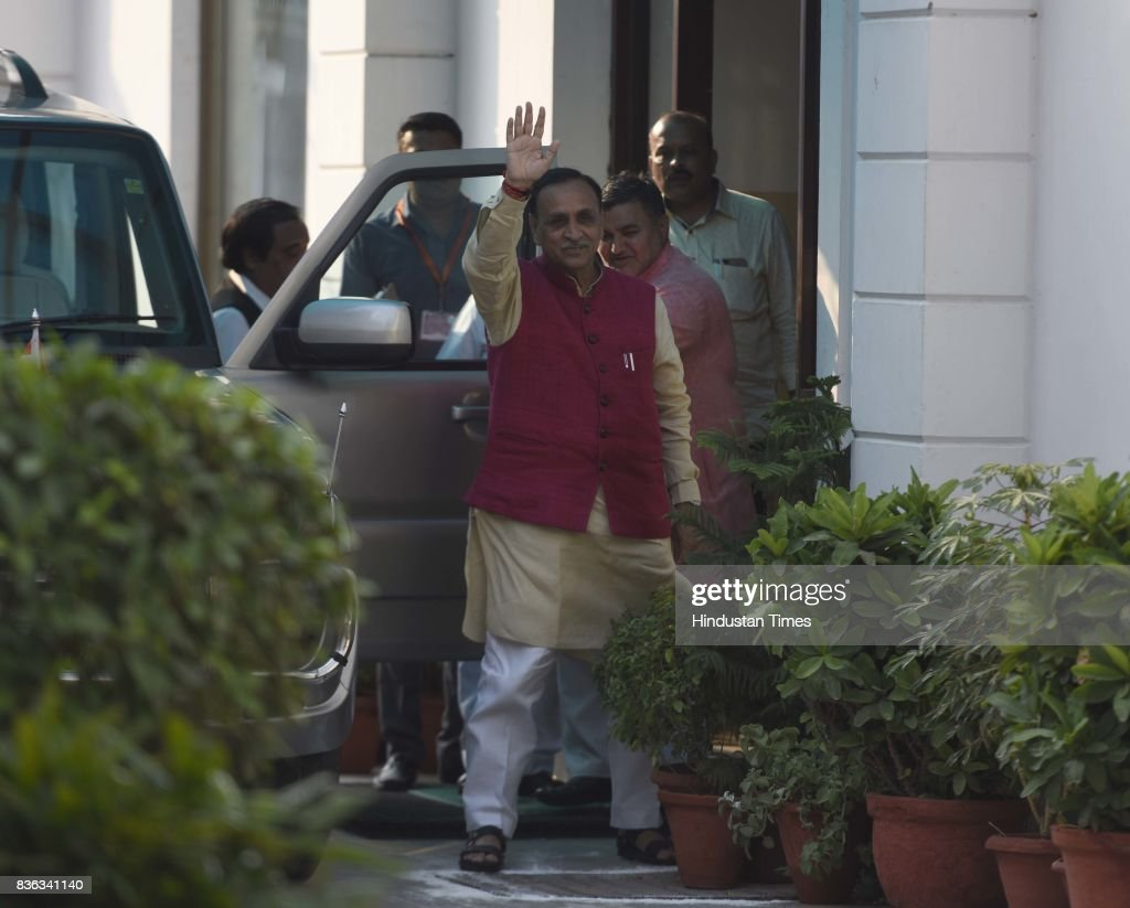 Gujarat Chief Minister Vijay Rupani arrives at BJP HQ for attending the BJP Chief Ministers' Conference addressed by Prime Minister Narendra Modi and BJP National President Amit Shah at Mukhyamatri Parishad Baithak (meeting of chief ministers of BJP-ruled states) on August 21, 2017 in New Delhi, India.