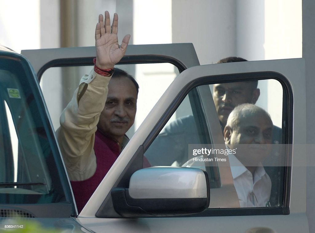 Gujarat Chief Minister Vijay Rupani with Gujarat Deputy Chief Minister Nitinbhai Patel arrives at BJP HQ for attending the BJP Chief Ministers' Conference addressed by Prime Minister Narendra Modi and BJP National President Amit Shah at Mukhyamatri Parishad Baithak (meeting of chief ministers of BJP-ruled states) on August 21, 2017 in New Delhi, India.