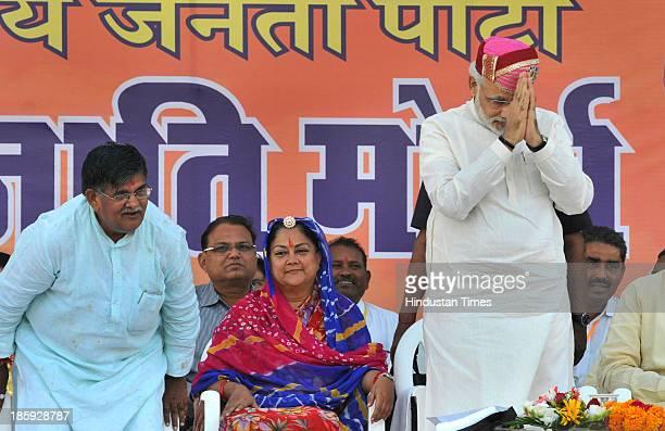 Gujarat CM and BJPs Prime Ministerial candidate Narendra modi Rajasthan former CM Vasundhara Raje and Leader of Opposition in Rajasthan Gulabchand...