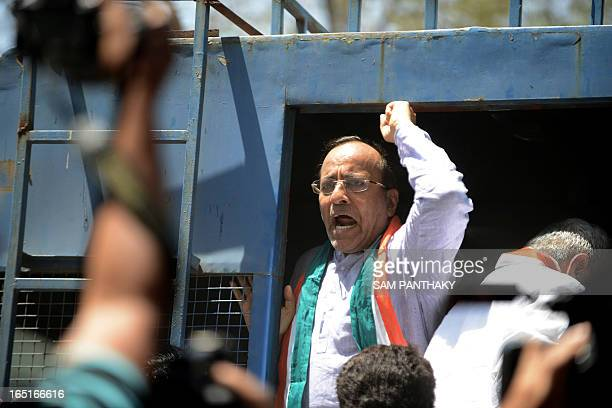 Gujarat Congress Party Chief Arjun Modhwadia shouts slogans from a vehicle during a protest rally in support of farmers in Gandhinagar some 30kms...