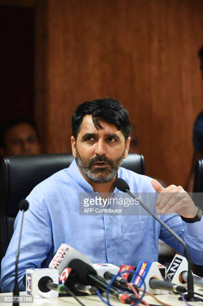 Gujarat Health Minister Shankarbhai Chaudhary briefs the media on the Swine flu at the Circuit House in Ahmedabad on August 12 2017 / AFP PHOTO / SAM...