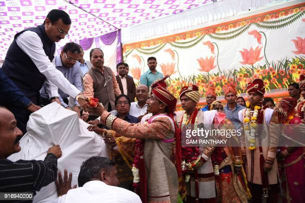 Gujarat minister of state for home Pradipsinh Jadeja Chief Principal Secretary to Gujarat Chief Minister K Kailashnathan greet the newly married...
