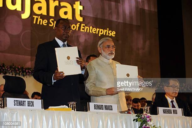 Gujarat state Chief Minister Narendra Modi and Prime Minister of Rwanda Bernard Makuza poses during Vibrant Gujarat 2011 at Mahatma Mandir in...