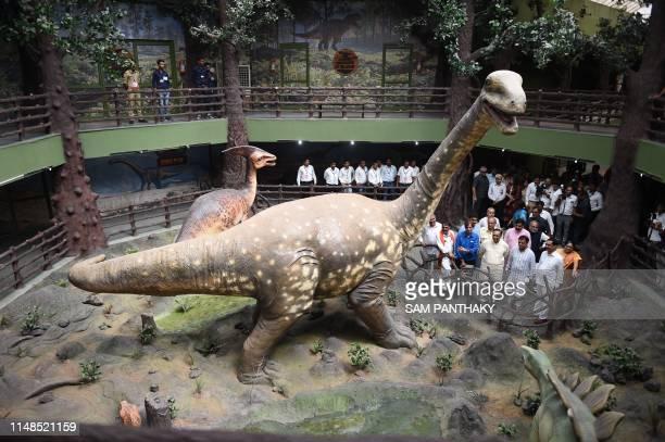 Gujarat state Chief Minister Vijaybhai Rupani along with senior ministers and oficials watch a Titanosaurus display after inaugurating the Dinosaur...