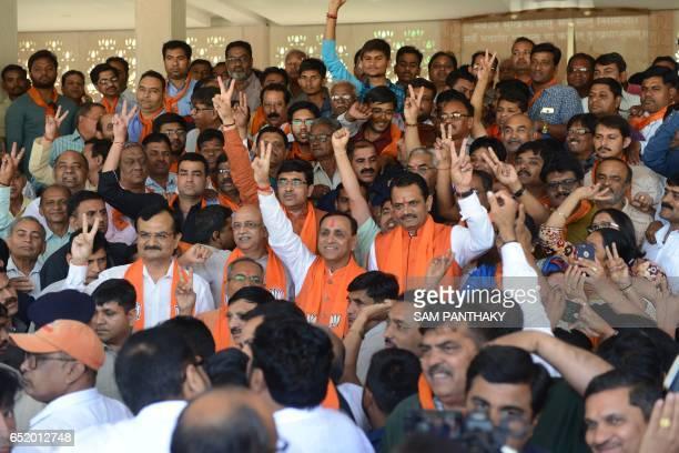 Gujarat state Chief Minister Vijaybhai Rupani Gujarat state Bhartiya Janta Party President Jitubhai Vaghani with other dignitaries and BJP supporters...