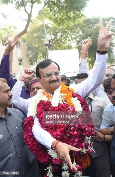 Gujarat State' Home Minister and Bhartiya Janta Party candidate from the Vatva onstituency Pradeepsinh Jadeja celebrates after winning the Gujarat...