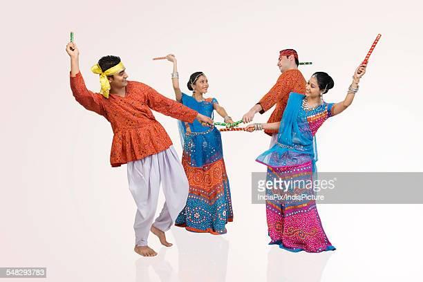 Gujarati couples performing dandiya
