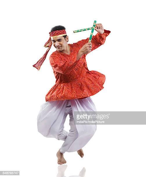 Gujarati man performing dandiya