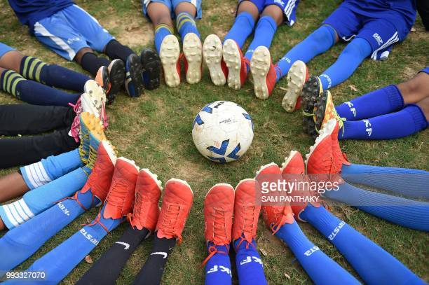 TOPSHOT Gujarati school children pose for a picture before their practice for the forthcoming Gothia Cup to be held in Gothenburg in Sweden on the...