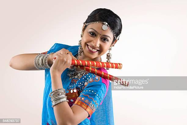Gujarati woman performing dandiya