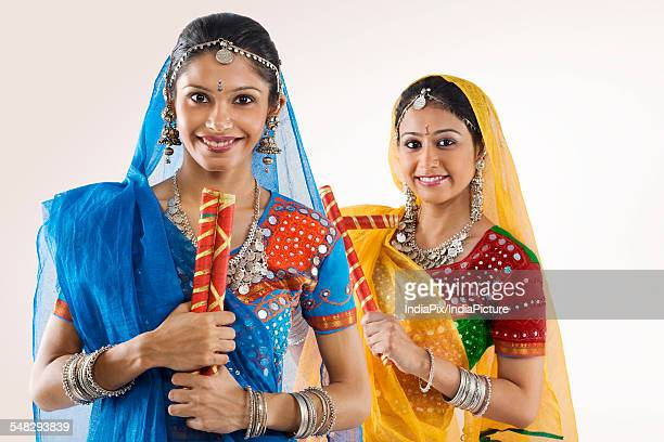 gujarati women with dandiya sticks - tradition stock pictures, royalty-free photos & images