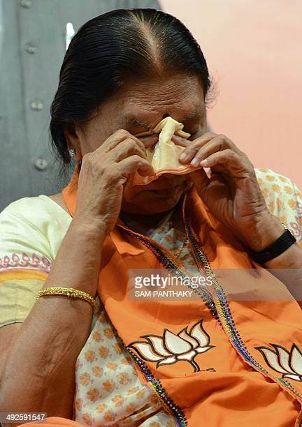 Gujarat's first woman chief minister Anandiben Patel gets emotional during a meeting at the Town Hall in Gandhinagar some 30 kms from Ahmedabad on...