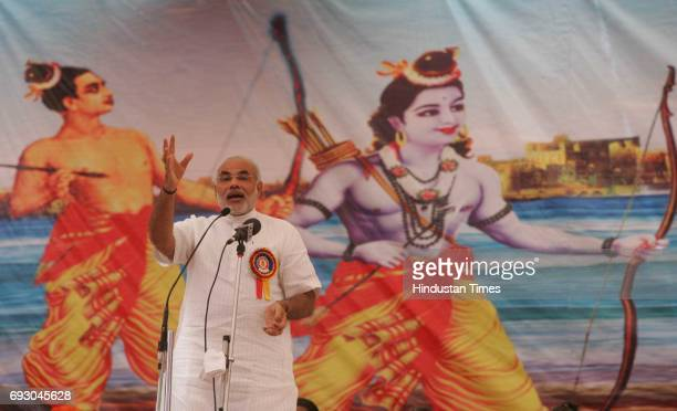 Gujrat CM Narendra Modi addressing the crowd on the first day of 'shabri kumbh festival' at shabridham in dang district Gujrat
