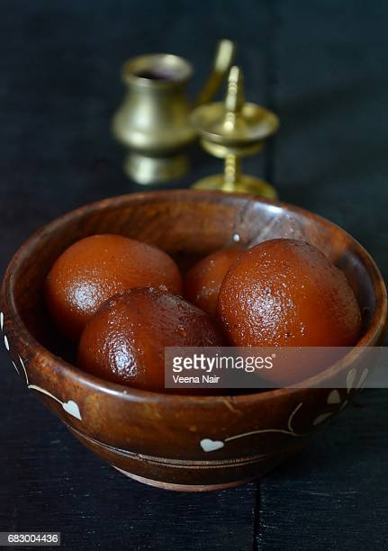 gulab jamun in a wooden bowl/indian dessert - angle poise lamp stock pictures, royalty-free photos & images