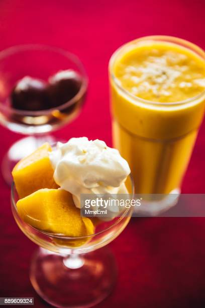 Gulab jamun, mango kulfi and lassi. North Indian food and desserts