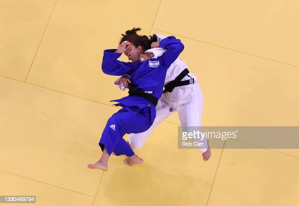 Gulbadam Babamuratova of Team Turkmenistan and Gili Cohen of Team Israel compete during the Women's Judo 52kg Elimination Round of 32 on day two of...