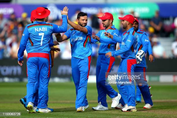 Gulbadin Naib of Afghanistan celebrates with his teammates after dismissing Aaron Finch of Australia during the Group Stage match of the ICC Cricket...