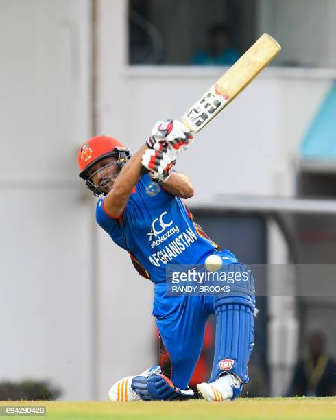 Gulbadin Naib of Afghanistan hits 6 during the 1st ODI match between West Indies and Afghanistan at Darren Sammy National Cricket Stadium Gros Islet...