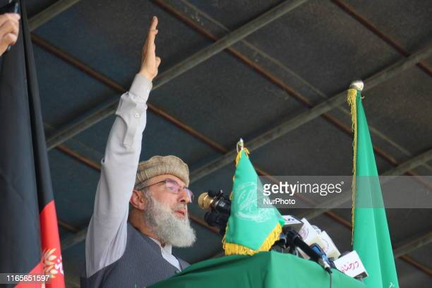 Gulbuddin Hekmatyar the reconciled leader of HizbeIslami who also runs for president talks with supporters during an election campaign in Badakhshan...