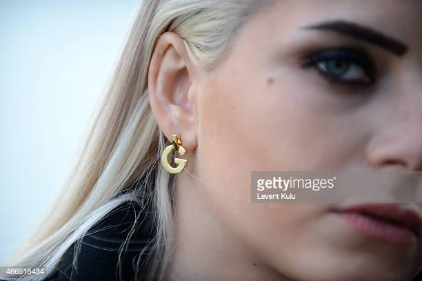 Gulce Dereli wears an earring of her own design during Mercedes Benz Fashion Week Istanbul FW15 on March 16 2015 in Istanbul Turkey