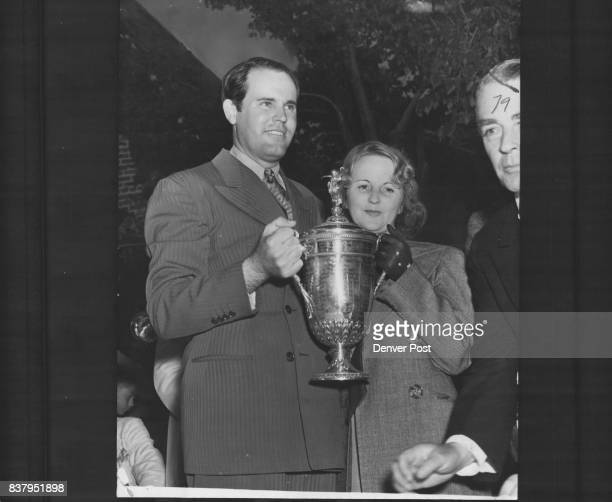 Guldahl accepts 1938 open trophy Ralph Guldahl named Tuesday to the Professional Golfers Association Hall of Fame is shown with wife accepting the...