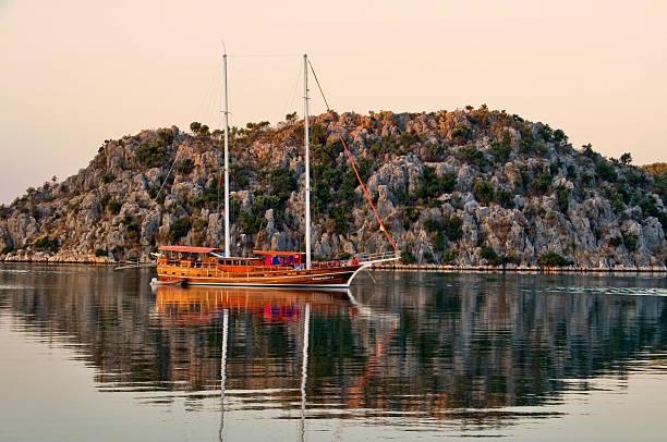 Gulet boat at Kalekoy harbour at dawn.