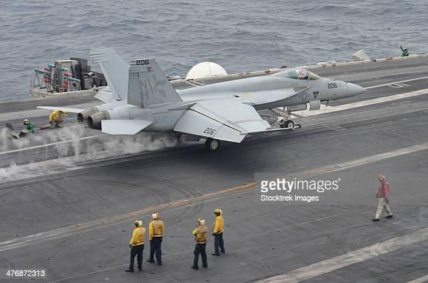 Gulf of Oman, August 22, 2013 - An F/A-18E Super Hornet launches from the flight deck of the aircraft carrier USS Nimitz.
