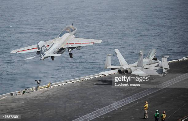 Gulf of Oman, July 12, 2013 - An EA-6B Prowler launches from the aircraft carrier USS Nimitz.