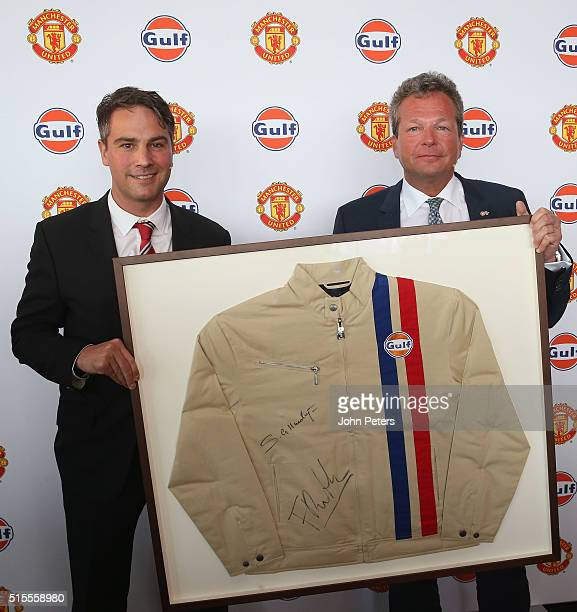 Gulf Oil International vice president Frank Rutten presents Jamie Reigle Manchester United Commercial Director with a signed Gulf Oil jacket at the...