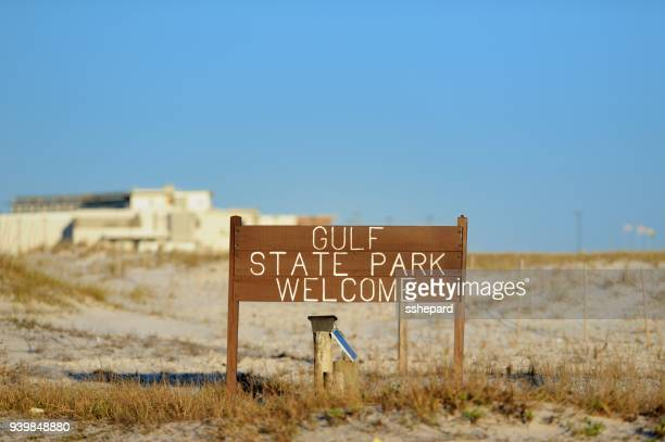 gulf state park welcome sign on beach - gulf shores alabama stock pictures, royalty-free photos & images