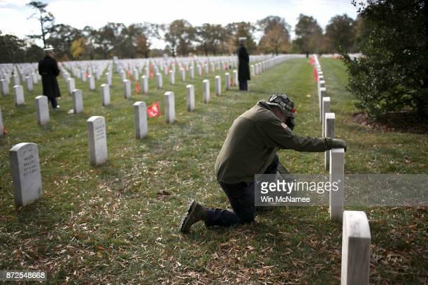 Gulf War veteran John Schoon visits the gravesite of USMC Sgt Christopher Hrbek one day before Veterans Day at Arlington National Cemetery November...