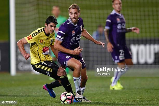 Guliherme Finkler of Wellington and Rostyn Griffiths of Perth compete for the ball during the round 22 ALeague match between the Wellington Phoenix...