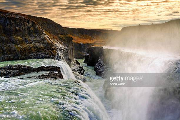 gullfoss waterfall at sunset, frost on cliffs - gullfoss falls stock photos and pictures