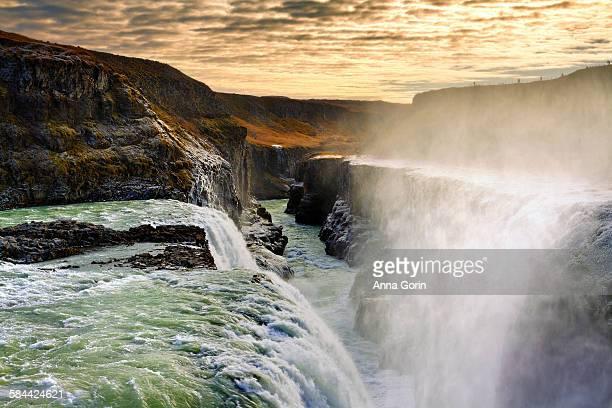 Gullfoss waterfall at sunset, frost on cliffs