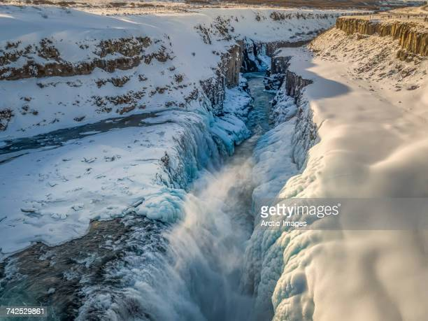Gullfoss waterfall, wintertime, Iceland. Gullfoss translated means Golden Falls. This image is shot with a drone.