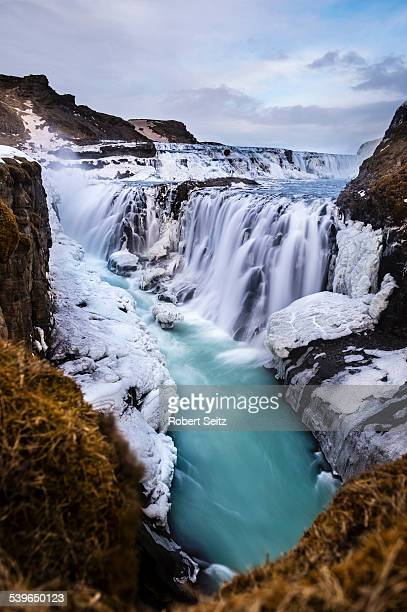 gullfoss waterfall, with ice and stones, vik, iceland - gullfoss falls stock photos and pictures