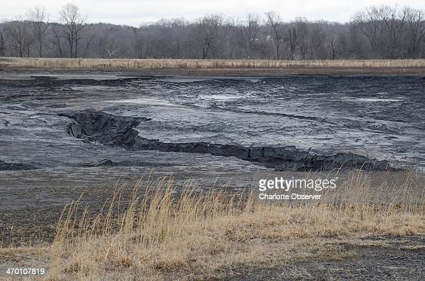 Gullies in the coal ash pond at the Duke Energy Dan River Steam Station show where coal ash flowed towards the Dan River beyond the far berm