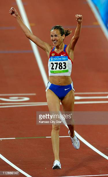 Gulnara GalkinaSamitova of Russia celebrates her gold medal and world record time in the 3000meter steeplechase on Sunday August 17 in the Games of...