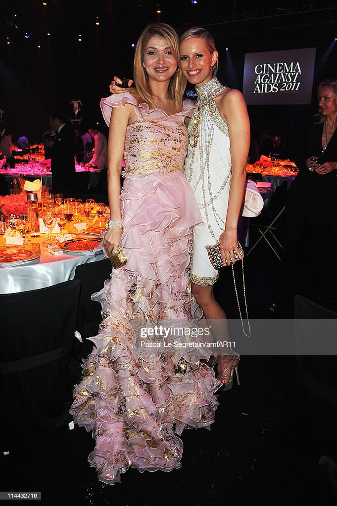 Gulnara Karimova and Karolina Kurkova attend amfAR's Cinema Against AIDS Gala during the 64th Annual Cannes Film Festival at Hotel Du Cap on May 19, 2011 in Antibes, France.