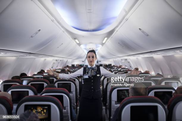 Gulnihal Pire a member of Turkish Airlines' flight attendant is seen on a plane in Ankara Turkey on May 23 2018 Gulnihal Pire also known for rescuing...