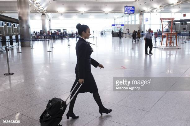 Gulnihal Pire a member of Turkish Airlines' flight attendant is seen at an airport in Ankara Turkey on May 23 2018 Gulnihal Pire also known for...