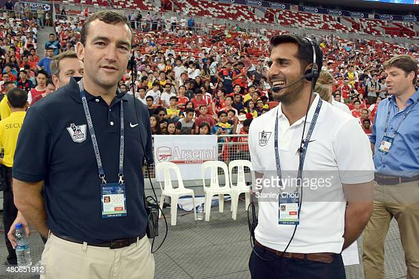 Gulraj Purewal of Premier League and an official at work during the Arsenal FC open training ahead of the match between Arsenal and Singapore during...