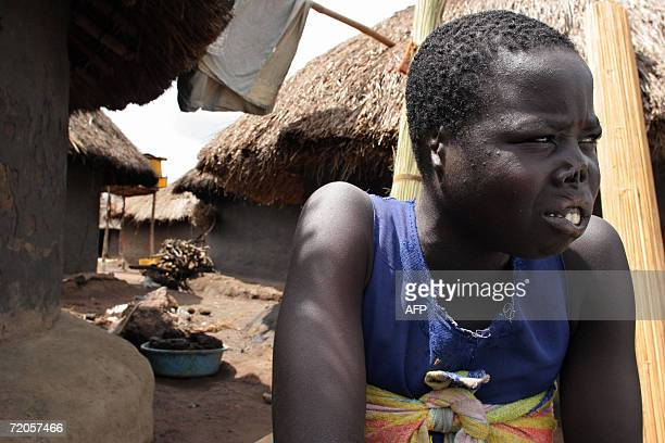 WITH AFP STORY A picture taken 02 September 2006 shows Auma Consolata a former abductee of the Lord's Resistance Army in 2005 when she was 17 bears...